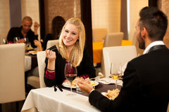 Young couple eat sea food dinner at restaurant and drink wine. Young people eat dinner at restaurant Stock Photography