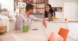 Young Couple Eating Breakfast In Kitchen Together Royalty Free Stock Image