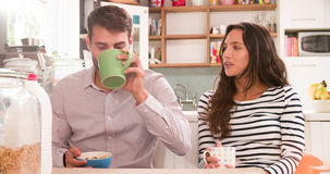 Young Couple Eating Breakfast In Kitchen Together Royalty Free Stock Photography