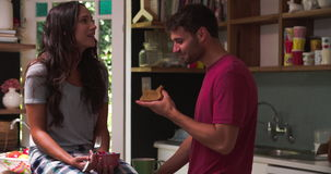Young Couple Eating Breakfast In Kitchen Together stock video footage