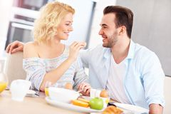 Young couple eating breakfast Royalty Free Stock Images