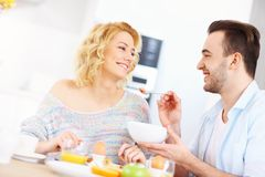 Young couple eating breakfast Royalty Free Stock Photography