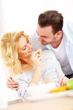 Young couple eating breakfast Royalty Free Stock Image