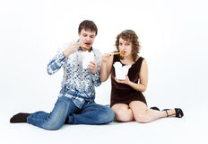 Young couple eating chinese food from lunch boxes Stock Photos