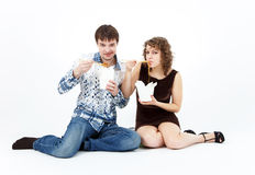 Young couple eating chinese food from lunch boxes Royalty Free Stock Images