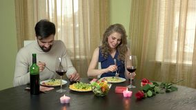 Young couple eating. Food and wine on table. What to order in restaurant stock video footage