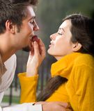Young couple eating grapes stock images
