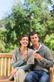 Young couple eating an ice cream Stock Image