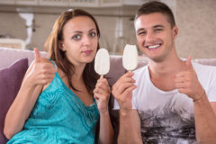 Young Couple Eating Ice Cream and Giving Thumbs Up Royalty Free Stock Photo