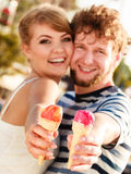 Young couple eating ice cream outdoor Royalty Free Stock Photo
