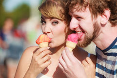 Young couple eating ice cream outdoor Stock Photography