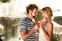 Young couple eating ice cream outdoor stock images
