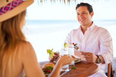 Young couple eating lunch at the beach Stock Photos