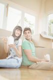 Young couple eating noodle Stock Photography