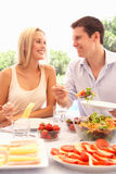 Young couple eating outdoors Stock Image