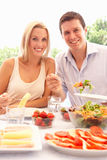 Young couple eating outdoors Stock Photography