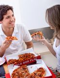 Young couple eating pizza Royalty Free Stock Image