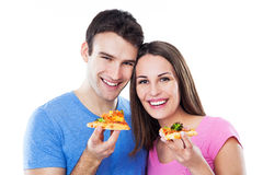 Young couple eating pizza stock photography