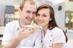 Young couple eating pizza Stock Images