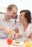 Young couple eating pizza Royalty Free Stock Photography