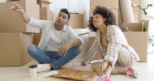 Young couple eating pizza and chatting Stock Photo