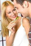 Young couple eating vegetable Stock Photos