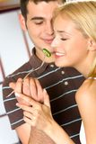 Young couple eating vegetable Stock Image