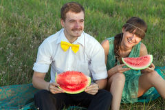 Young couple eating watermelon Stock Image
