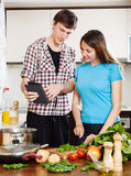 Young couple  with eBook Stock Images