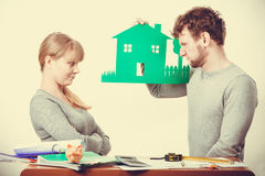 Young couple with ecological green house. Ecology in practical domestic life. People real estate and house concept. Young dissatisfied couple with green stock photography