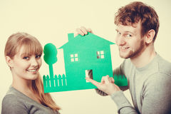 Young couple with ecological green house. Royalty Free Stock Photography