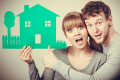 Young couple with ecological green house. Royalty Free Stock Photos