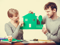 Young couple with ecological green house. Stock Images
