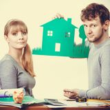 Young couple with ecological green house. Royalty Free Stock Photo