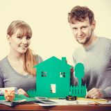 Young couple with ecological green house. Stock Image