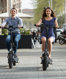 Young couple on electric bikes stock image
