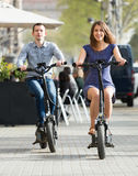 Young couple with electric bikes stock photo