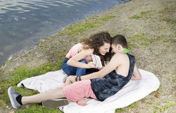 Young couple with electronic device Royalty Free Stock Photography