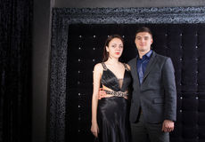 Young Couple in Elegant Outfits Looking at Camera Stock Photography