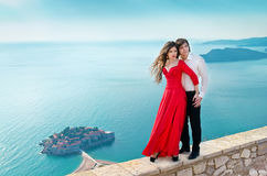 Young couple embraccing over the sea on romantic travel honeymoo Stock Photos