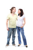 Young couple in embrace. Young couple in jeans, boy and girl, are standing in embrace and looking at each other Stock Photos