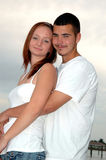 Young couple embrace. A happy young couple in an embrace outdoors Royalty Free Stock Photos