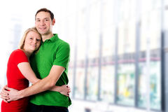 Young couple in an embrace. Young couple in embrace in front of bright background Royalty Free Stock Photography