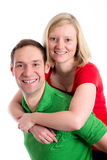 Young couple in an embrace. In front of white background Stock Photography