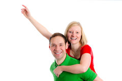 Young couple in an embrace. In front of white background Royalty Free Stock Photo