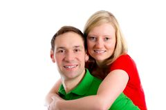 Young couple in an embrace. In front of white background Royalty Free Stock Images