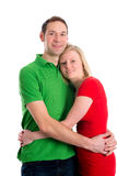 Young couple in an embrace. In front of white background Stock Photos
