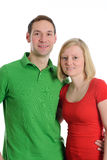 Young couple in an embrace. In front of white background Royalty Free Stock Photography