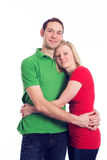 Young couple in an embrace. In front of white background Royalty Free Stock Image