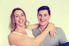 Young couple in an embrace. In front of white background Stock Image